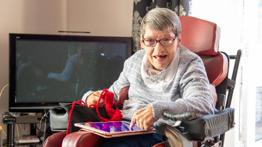 Lady in wheel chair at specialist disability care facility